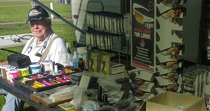 Jim selling shotgun supplies at his stand.